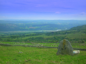 Dagon stone with view of Tal y fan mountains